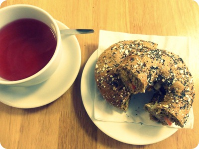 cranberry and pomegranate tea, multiseed bagel with falafel and hummus