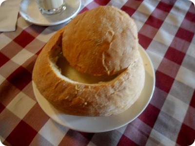 Slovak garlic soup with cheese, in a bread bowl